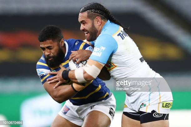 Michael Jennings of the Eels is tackled by Konrad Hurrell of the Titans during the round 21 NRL match between the Parramatta Eels and the Gold Coast...