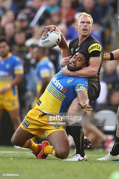 Michael Jennings of the Eels is tackled by Peter Wallace of the Panthers during the round 19 NRL match between the Penrith Panthers and the...