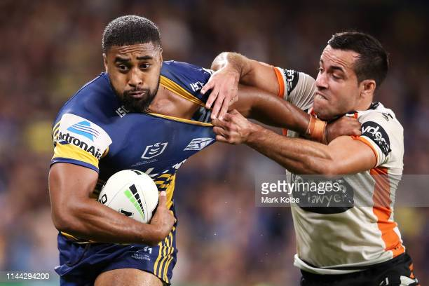 Michael Jennings of the Eels is tackled Corey Thompson of the Tigers during the round 6 NRL match between the Parramatta Eels and Wests Tigers at...