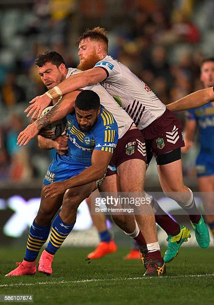 Michael Jennings of the Eels is tackled during the round 22 NRL match between the Parramatta Eels and the Manly Sea Eagles at Pirtek Stadium on...