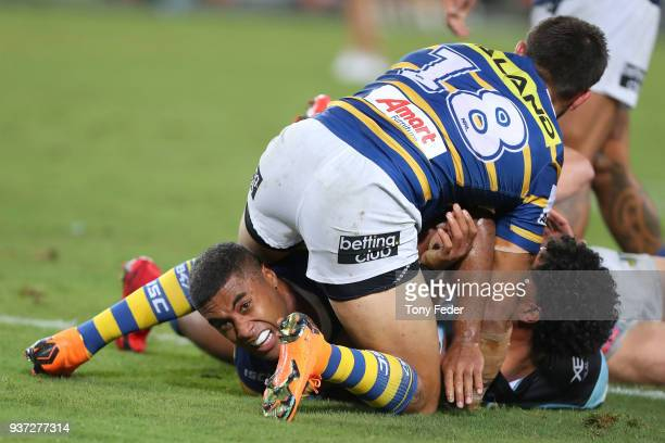 Michael Jennings of the Eels is tackled during the round three NRL match between the Parramatta Eels and the Cronulla Sharks at ANZ Stadium on March...