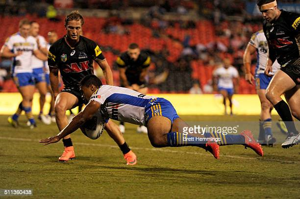 Michael Jennings of the Eels scores a try during the NRL Trial match between the Penrith Panthers and the Parramatta Eels at Pepper Stadium on...