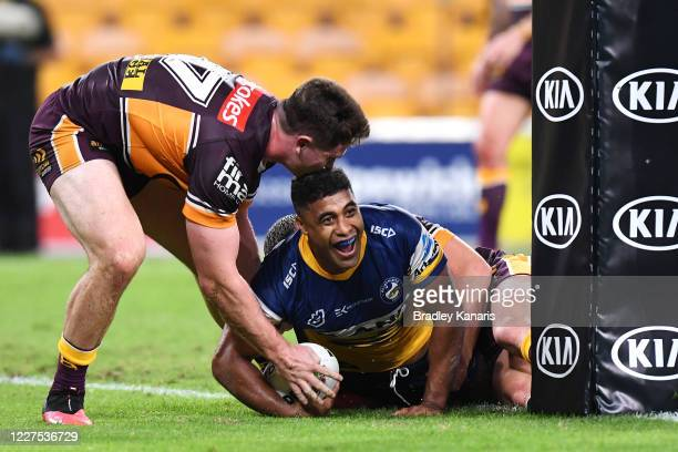 Michael Jennings of the Eels scores a try during the round three NRL match between the Brisbane Broncos and the Parramatta Eels at Suncorp Stadium on...