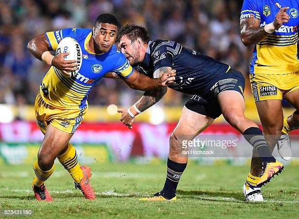 Michael Jennings of the Eels skips out of a tackle of Kyle Feldt of the Cowboys during the round eight NRL match between the North Queensland Cowboys...