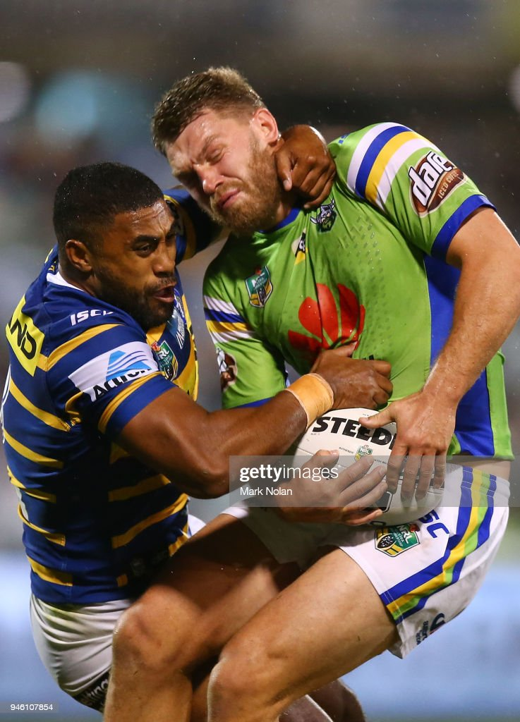 Michael Jennings of the Eels tackles Elliot Whitehead of the Raiders high during the round six NRL match between the Canberra Raiders and the Parramatta Eels at GIO Stadium on April 14, 2018 in Canberra, Australia.