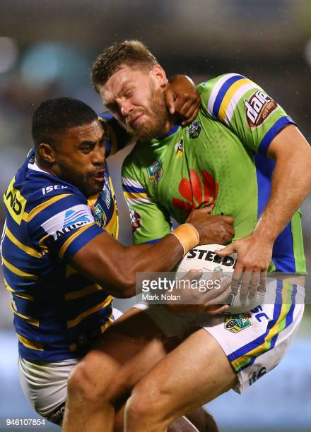 Michael Jennings of the Eels tackles Elliot Whitehead of the Raiders high during the round six NRL match between the Canberra Raiders and the...