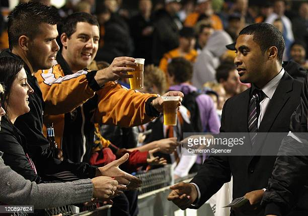 Michael Jennings of the Panthers hands tickets out to the crowd at halftime during the round 23 NRL match between the Penrith Panthers and the Wests...