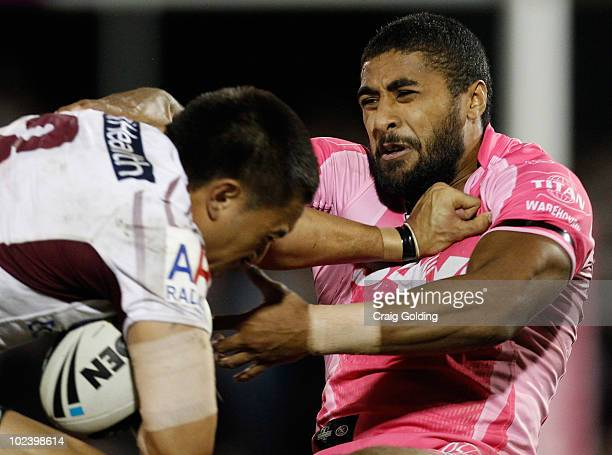 Michael Jennings of the Panthers is tackles Dean Whare of the Sea Eagles during the round 16 NRL match between the Penrith Panthers and the Manly Sea...