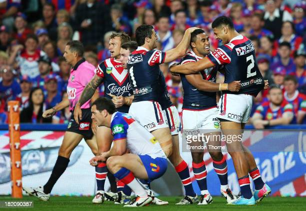 Michael Jennings of the Roosters celebrates with team mates after scoring a try during the NRL Preliminary Final match between the Sydney Roosters...
