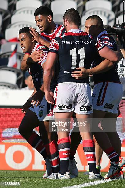 Michael Jennings of the Roosters celebrates with team mates after scoring a try during the round 16 NRL match between the Sydney Roosters and the...