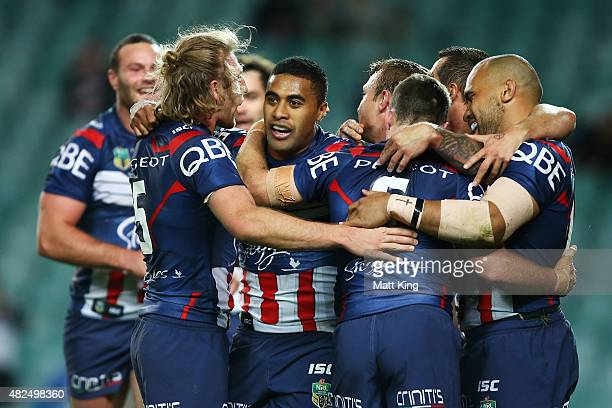 Michael Jennings of the Roosters celebrates with team mates after scoring a try during the round 21 NRL match between the Sydney Roosters and the...