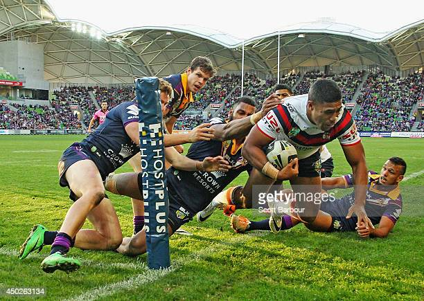 Michael Jennings of the Roosters is pushed into touch just short of the try line during the round 13 NRL match between the Melbourne Storm and the...