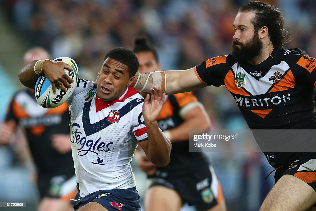 Michael Jennings of the Roosters is tackled by Aaron Woods of the Wests Tigers after making a break during the round 20 NRL match between the Wests Tigers and the Sydney Roosters at ANZ Stadium on July 24, 2015 in Sydney, Australia.