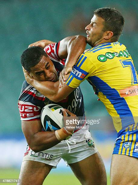 Michael Jennings of the Roosters is tackled by Luke Kelly during the round two NRL match between the Sydney Roosters and the Parramatta Eels at...