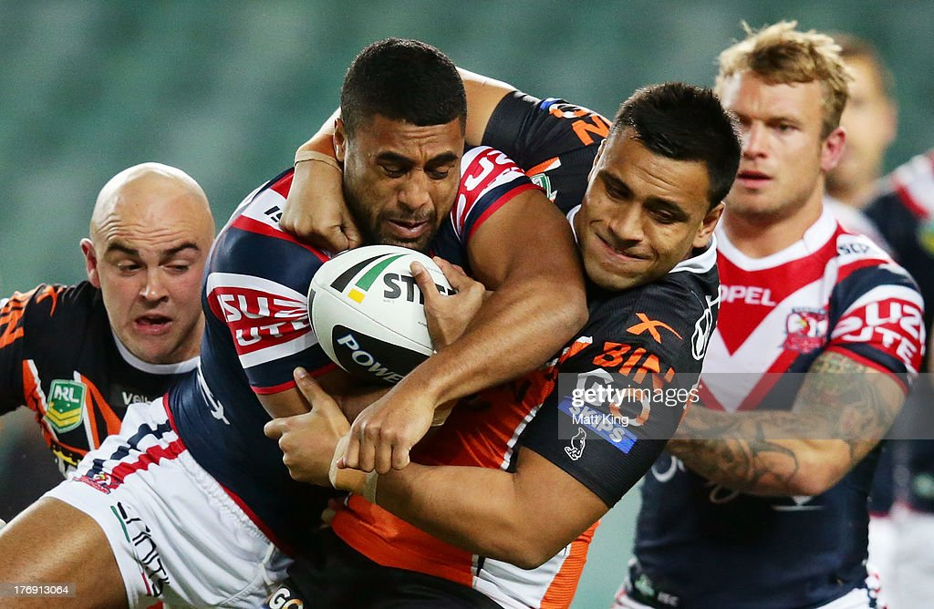 Michael Jennings of the Roosters is tackled during the round 23 NRL match between the Wests Tigers and the Sydney Roosters at Allianz Stadium on August 19, 2013 in Sydney, Australia.
