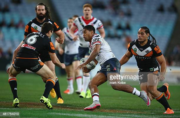 Michael Jennings of the Roosters makes a break during the round 20 NRL match between the Wests Tigers and the Sydney Roosters at ANZ Stadium on July...