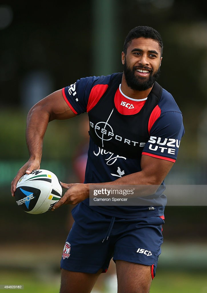 Michael Jennings of the Roosters passes during a Sydney Roosters NRL training session at Kippax Lake on September 3, 2014 in Sydney, Australia.