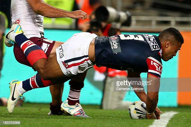 Michael Jennings of the Roosters scores a try during the 2013 NRL Grand Final match between the Sydney Roosters and the Manly Warringah Sea Eagles at...