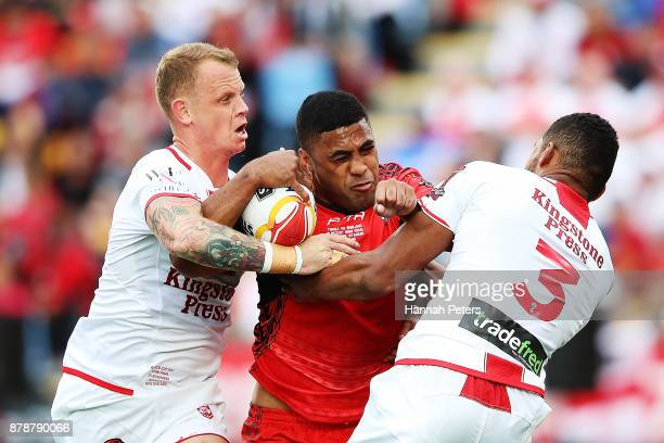 Michael Jennings of Tonga charges forward during the 2017 Rugby League World Cup Semi Final match between Tonga and England at Mt Smart Stadium on...