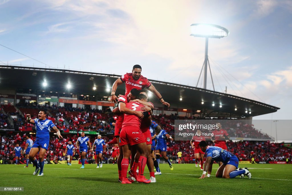 Michael Jennings of Tonga is mobbed by teammates after scoring a try during the 2017 Rugby League World Cup match between Samoa and Tonga at Waikato Stadium on November 4, 2017 in Hamilton, New Zealand.