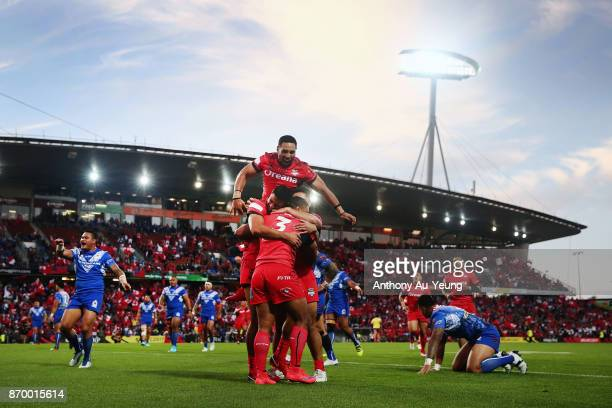 Michael Jennings of Tonga is mobbed by teammates after scoring a try during the 2017 Rugby League World Cup match between Samoa and Tonga at Waikato...