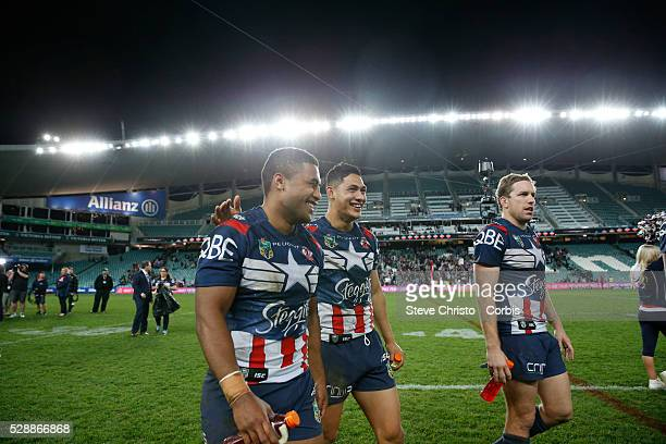 Michael Jennings, Roger Tuivasa-Sheck and Mitchell Aubusson of the Roosters walk off after beating the Bulldogs 32-28 after the round 21 NRL match...