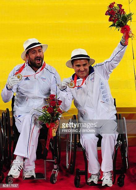 Michael Jeremiasz and Stephane Houdet of France hold their gold medals following victory over Sweden's Stefan Olsson and Peter Wikstrom in the men's...