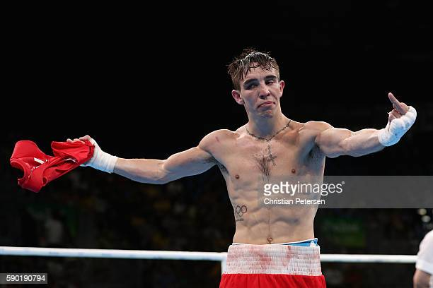 Michael John Conlan of Ireland jestures to the crowd after his defeat to Vladimir Nikitin of Russia in the boxing Men's Bantam Quarterfinal 1 on Day...