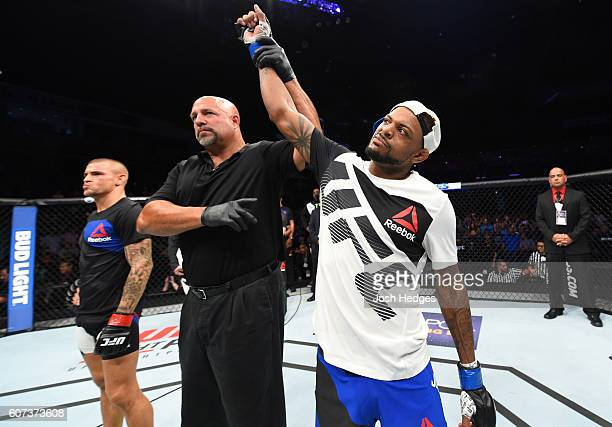 Michael Johnson celebrates his knockout victory over Dustin Poirier in their lightweight bout during the UFC Fight Night event at State Farm Arena on...