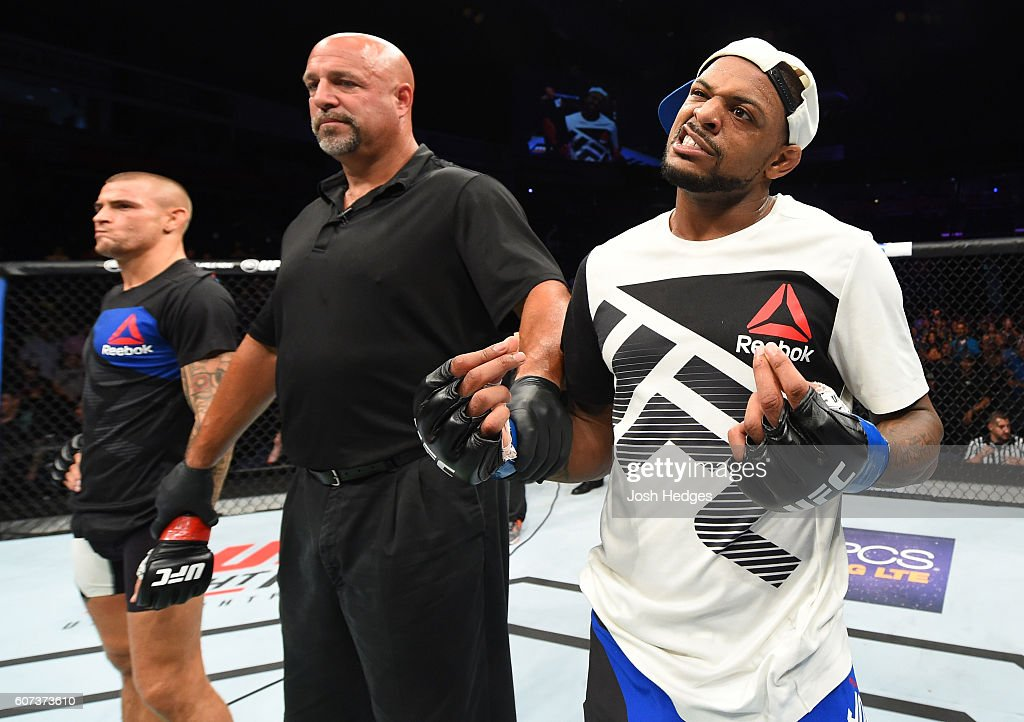 Michael Johnson celebrates his knockout victory over Dustin Poirier in their lightweight bout during the UFC Fight Night event at State Farm Arena on September 17, 2016 in Hidalgo, Texas.