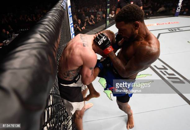 Michael Johnson knees Justin Gaethje after their lightweight bout during The Ultimate Fighter Finale at TMobile Arena on July 7 2017 in Las Vegas...