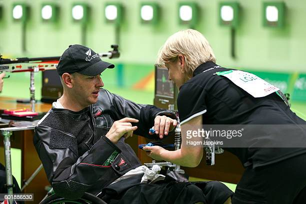 Michael Johnson of New Zealand takes his earpieces out after competing in the R4 Mixed 10m Air Rifle Standing SH2 qualification round on day 3 of the...