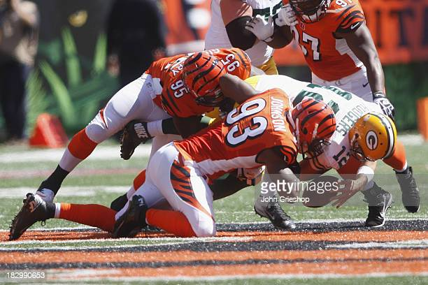 Michael Johnson of the Cincinnati Bengals sacks Aaron Rodgers of the Green Bay Packers during their game at Paul Brown Stadium on September 22 2013...