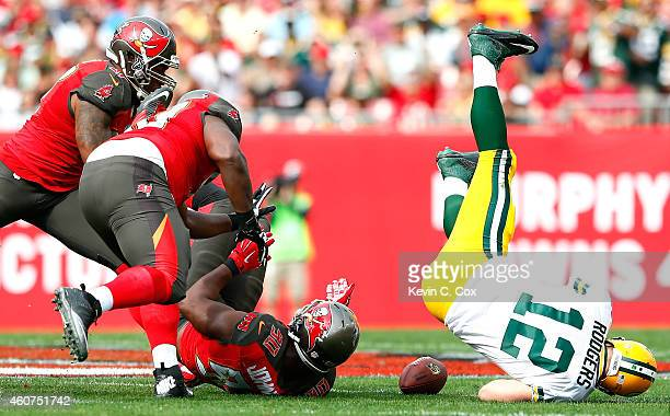 Michael Johnson of the Tampa Bay Buccaneers forces a fumble by Aaron Rodgers of the Green Bay Packers at Raymond James Stadium on December 21 2014 in...