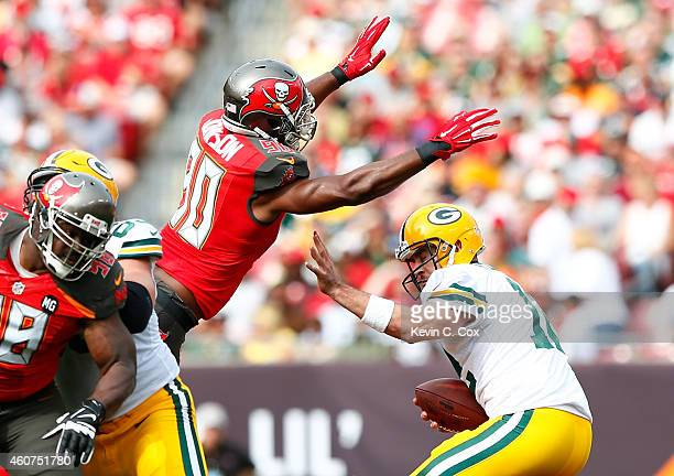 Michael Johnson of the Tampa Bay Buccaneers pressures Aaron Rodgers of the Green Bay Packers and forces a fumble at Raymond James Stadium on December...