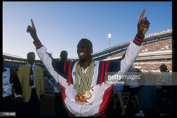 Michael Johnson of the United States displays three gold medals he won during the World Championships in Gothenburg, Sweden. Mandatory Credit: Mike...