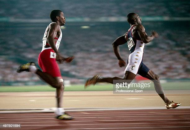 Michael Johnson of the United States en route to winning the gold medal from Frankie Fredericks of Namibia in the men's 200 metres event during the...