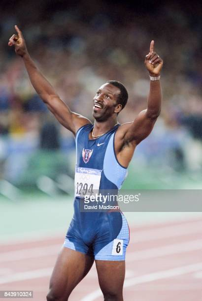 Michael Johnson of the USA celebrates after winning the Men's 400 meter final of the 2000 Olympic Games held on September 25 2000 at Olympic Stadium...