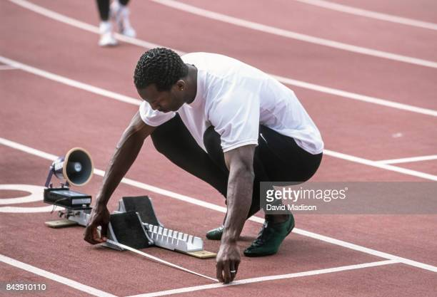 Michael Johnson of the USA prepares to run the final of the Men's 400 meter event of the 2000 USA Track and Field Olympic Trials held at Hornet...