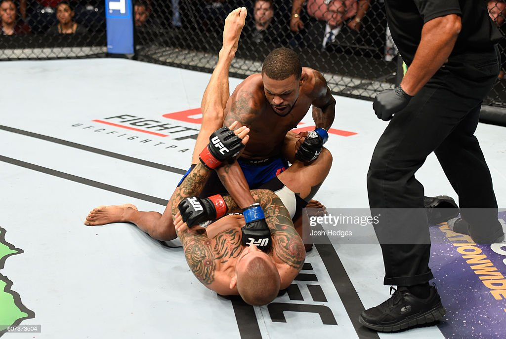 Michael Johnson (top) punches Dustin Poirier in their lightweight bout during the UFC Fight Night event at State Farm Arena on September 17, 2016 in Hidalgo, Texas.