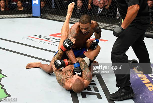 Michael Johnson punches Dustin Poirier in their lightweight bout during the UFC Fight Night event at State Farm Arena on September 17 2016 in Hidalgo...