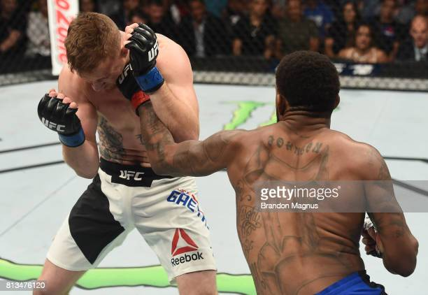 Michael Johnson punches Justin Gaethje after their lightweight bout during The Ultimate Fighter Finale at TMobile Arena on July 7 2017 in Las Vegas...