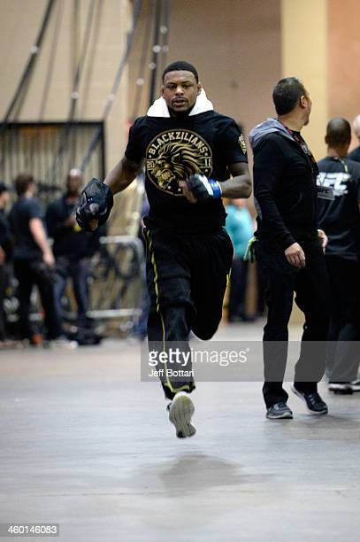 Michael Johnson warms up before his lightweight bout against Gleison Tibau during the UFC 168 event at the MGM Grand Garden Arena on December 28,...