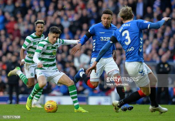 Michael Johnston of Celtic is closed down by James Tavernier and Joseph Worrall of Rangers during the Ladbrokes Scottish Premiership match between...