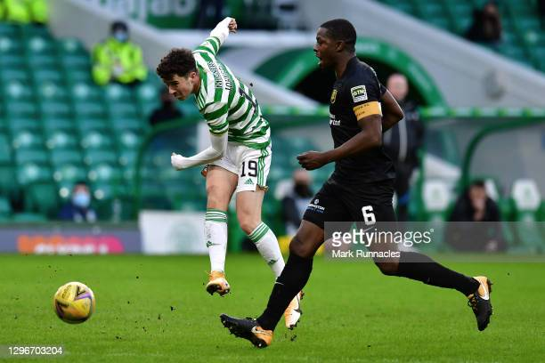 Michael Johnston of Celtic shoots under pressure from Marvin Bartley of Livingston FC during the Ladbrokes Scottish Premiership match between Celtic...