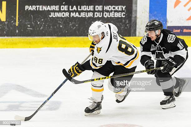 Michael Joly of the Cape Breton Screaming Eagles skates the puck against Alexandre DelisleHoude of the BlainvilleBoisbriand Armada during the QMJHL...