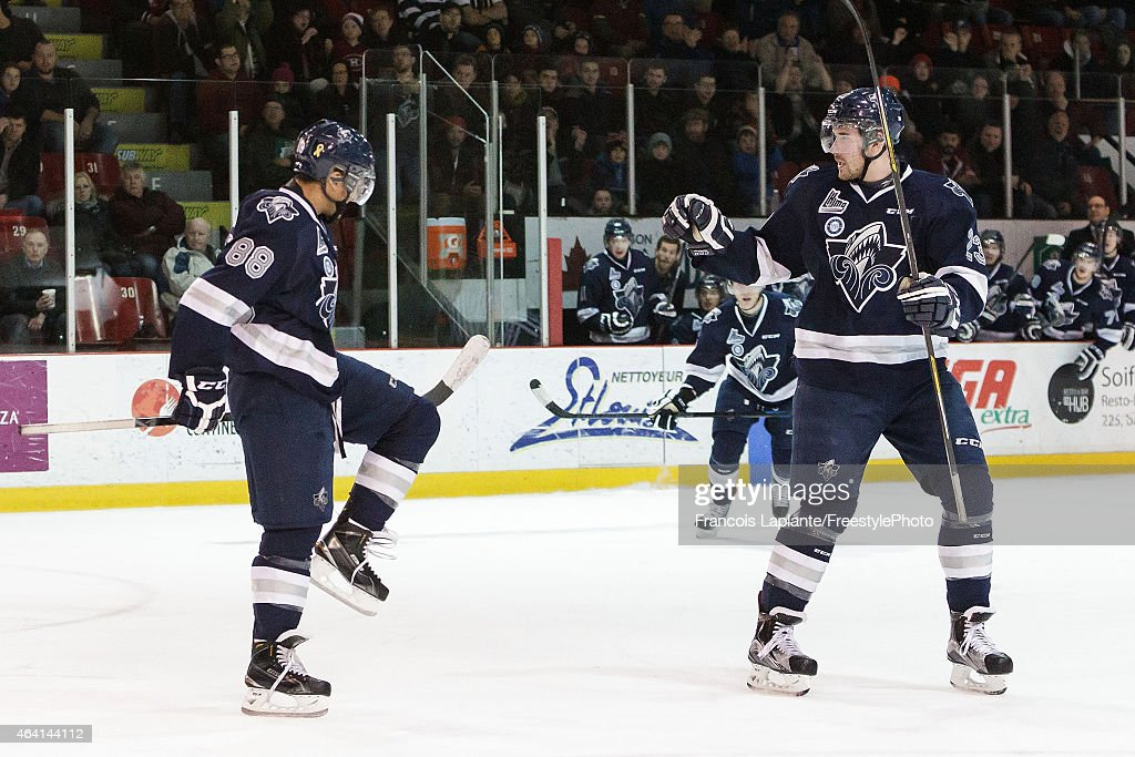 Michael Joly #88 of the Rimouski Oceanic celebrates his first period goal along with teammate Frederik Gauthier #23 against the Gatineau Olympiques on February 22, 2015 at Robert Guertin Arena in Gatineau, Quebec, Canada.