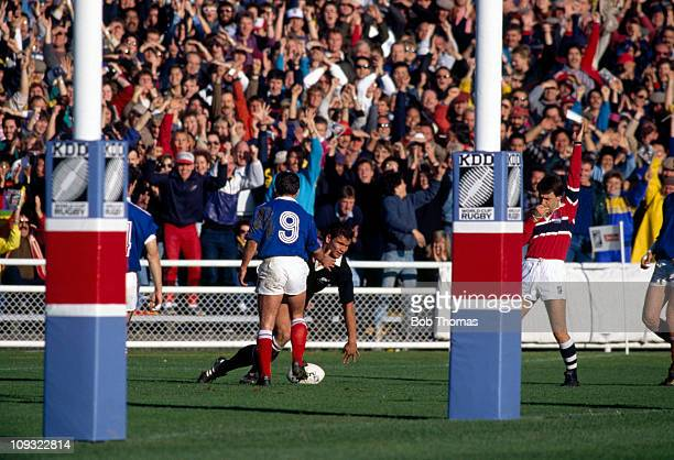 Michael Jones of New Zealand crosses the French line for a Try during the Rugby Union World Cup Final held in Auckland on 20th June 1987 New Zealand...