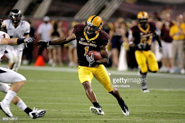 Michael Jones of the Arizona State Sun devils runs for a long gain after a catch during the Northern Arizona Lumberjacks Arizona State Sun Devils...