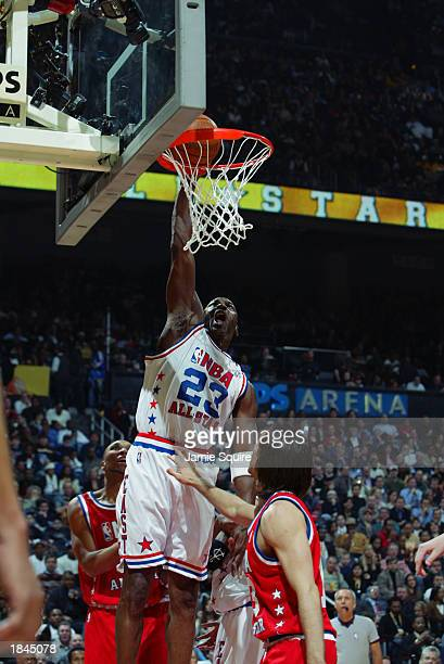 Michael Jordan of the Eastern Conference AllStars dunks against the Western Conference AllStars during the 2003 NBA AllStar Game on February 9 2003...